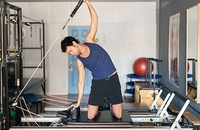 man using Pilates Reformer