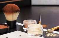 makeup and brushes on table