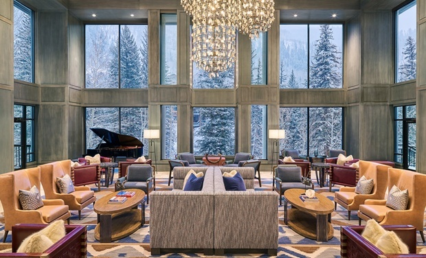 Elegant lobby with piano and chandelier at Hotel Talisa