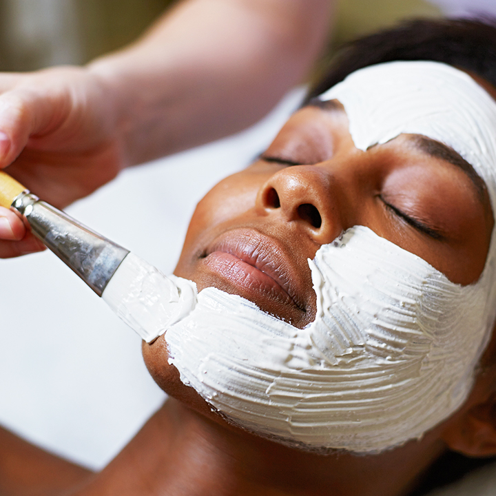 Woman getting a spa facial mask.