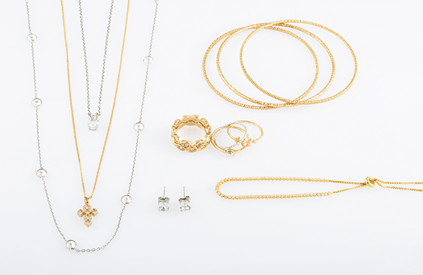Assorted gold and silver jewelry with bracelets, necklaces, and earrings