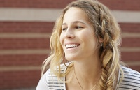 woman with loose braid smiling