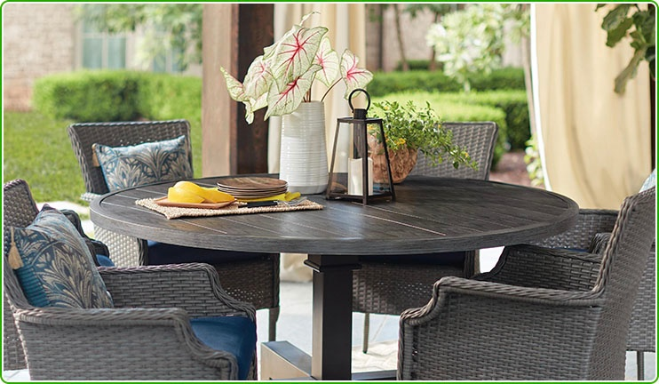 Round patio table with 4 wicker chairs