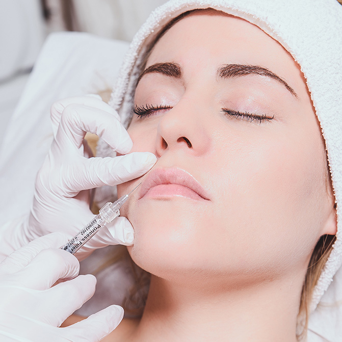Woman getting filler injected near her mouth