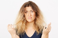 woman bewildered with her frizzy hair
