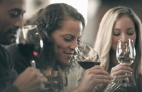 woman sniffing her glass of wine