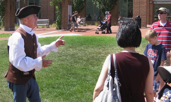 Man in colonial clothing leading tour