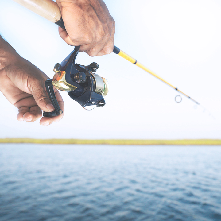 hands holding a rod while fishing