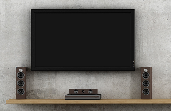 wall-mounted flat screen television with home sound system speakers