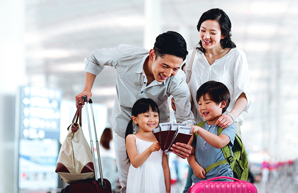 family at airport traveling flying for the holidays jpg