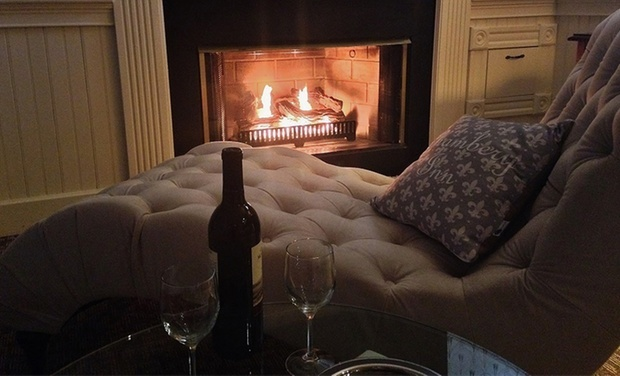 Fireplace with wine at Chambery Inn