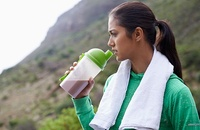 woman-drinking-post-workout-sports-supplement