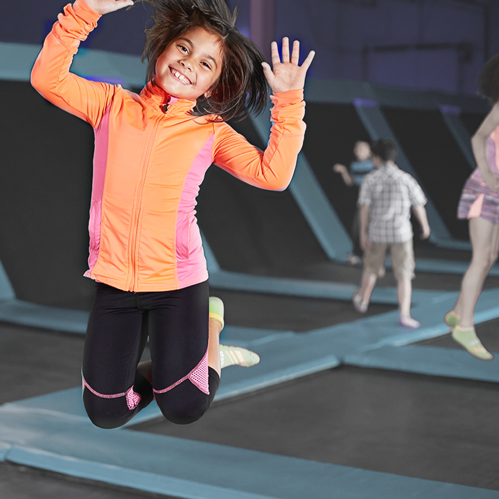 Child enjoying a trampoline park