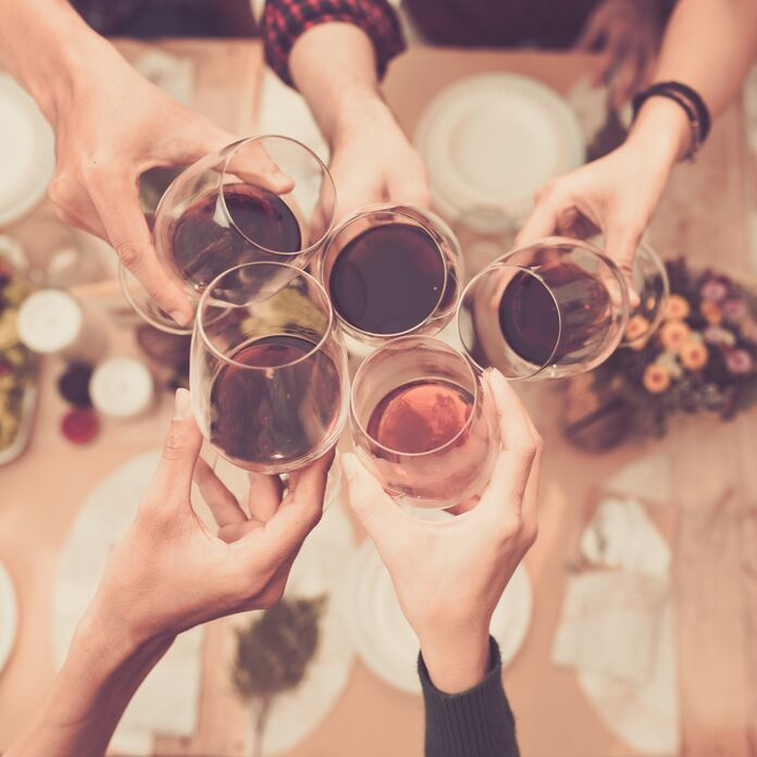 Friends cheersing with glasses of wine
