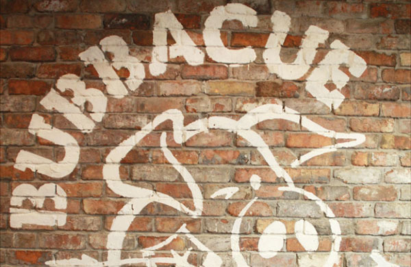 The Bubbacue logo painted on to a brick wall at Bubbacue in Belfast