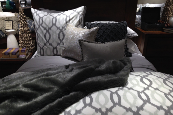 Bed display with a grey colour palette in West Elm