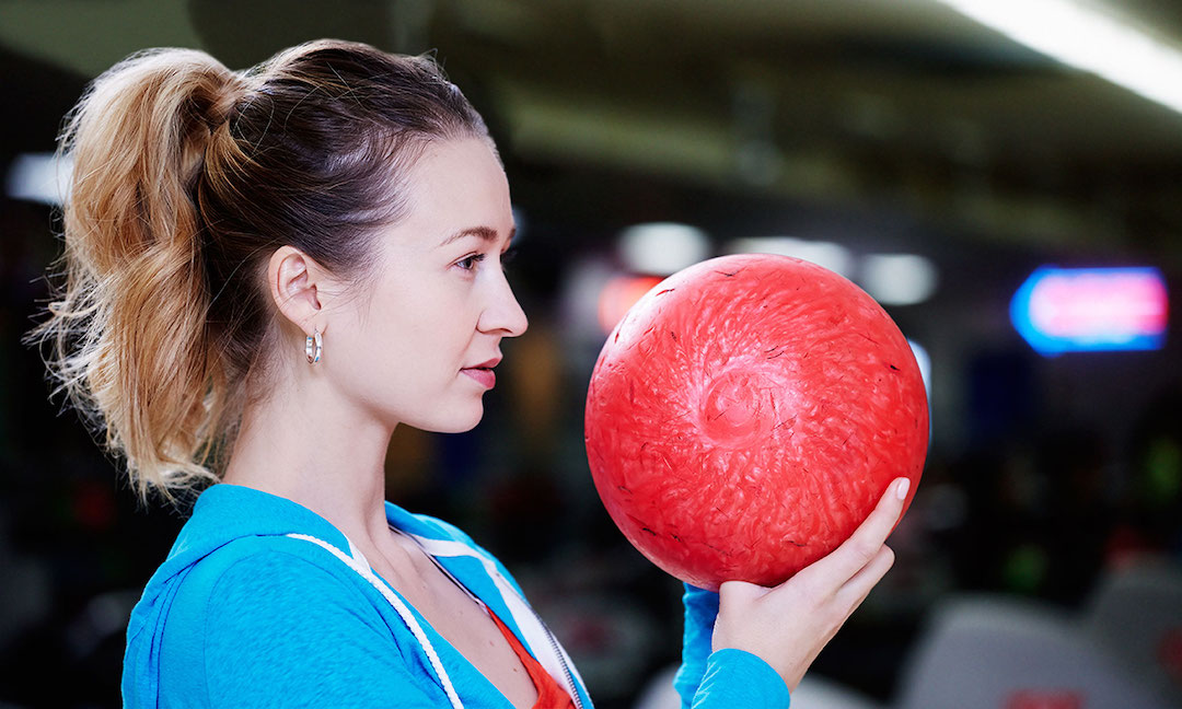 Woman holding bowling ball