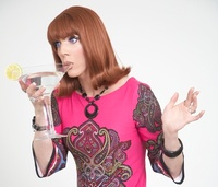 Drag star drinking cocktail