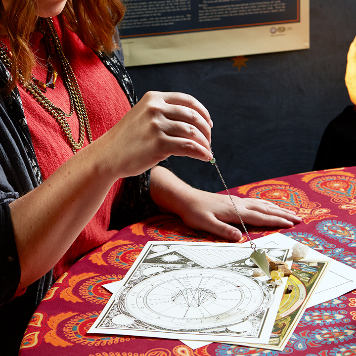 Woman reading astrological Birth Charts