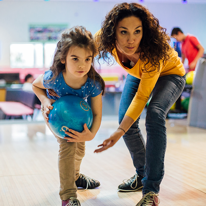 Mom and daughter bowling