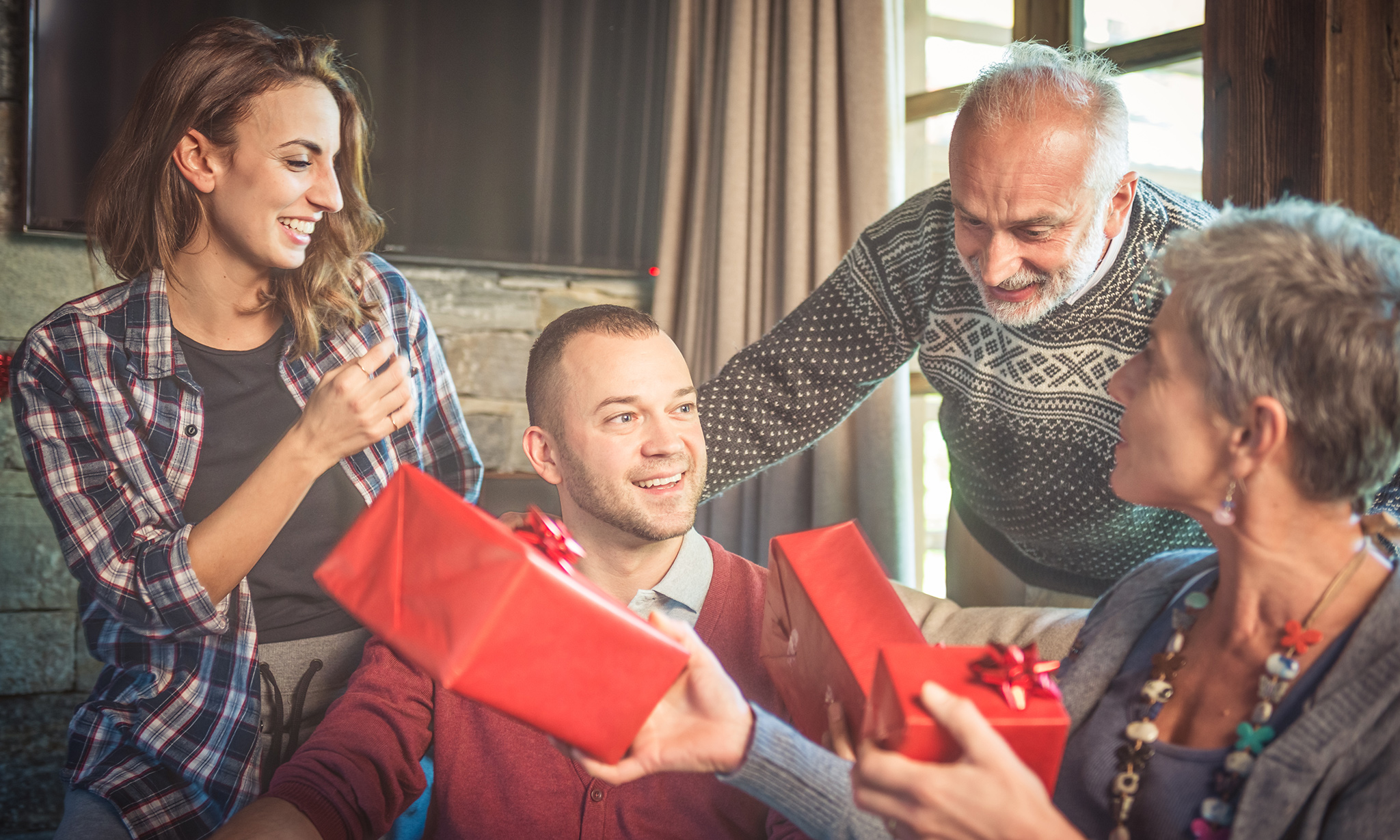 Family exchanging gifts