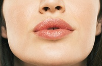 woman with oil on lips
