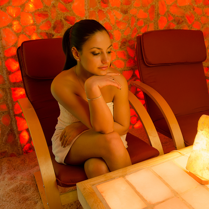 Woman relaxing in a salt cave