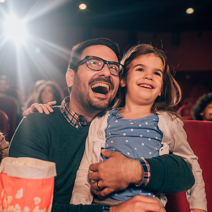 Daughter and Father at the Movie Theater