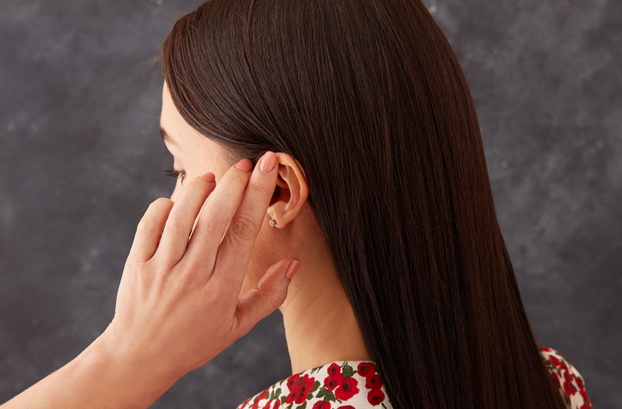 woman touching her hair after a keratin smoothing treatment