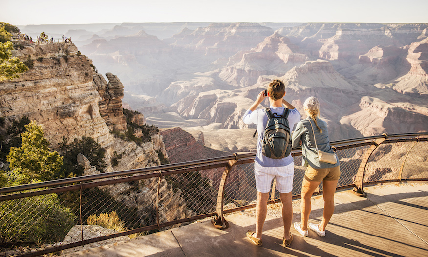 People looking out over Grand Canyon
