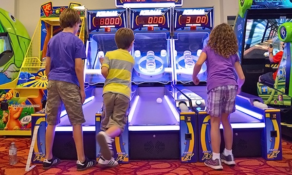 Kids playing Skee-Ball