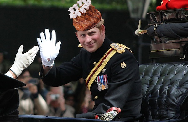 Britain's Prince Harry Celebrates National Crown Roast of Pork Day in the Traditional Manner