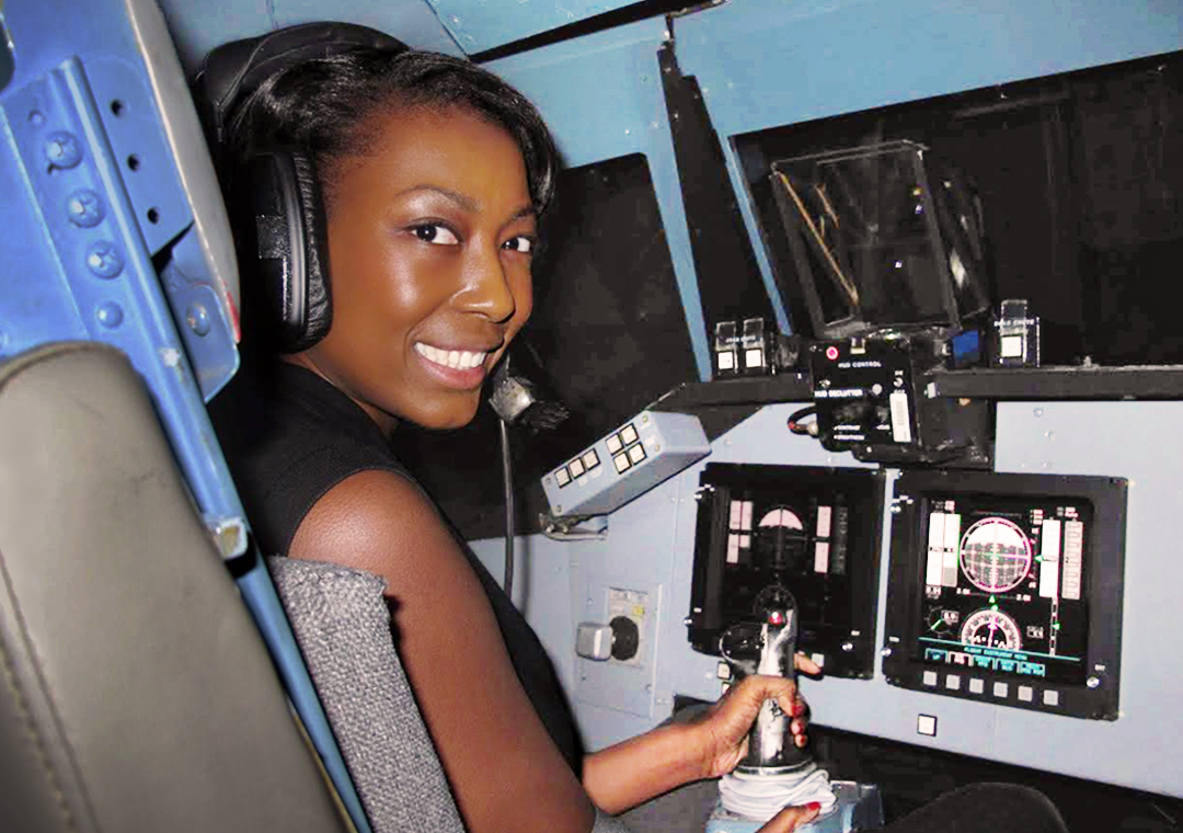 Aisha Bowe sitting in cockpit