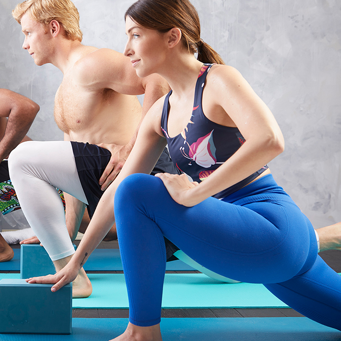 People stretching in a yoga class