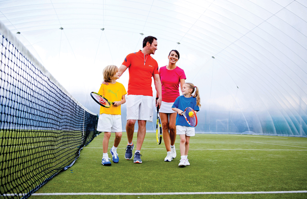Family on a tennis court at David Lloyd Gym in London