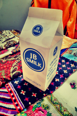 A box with JB Smilk Vintage Clothing logo