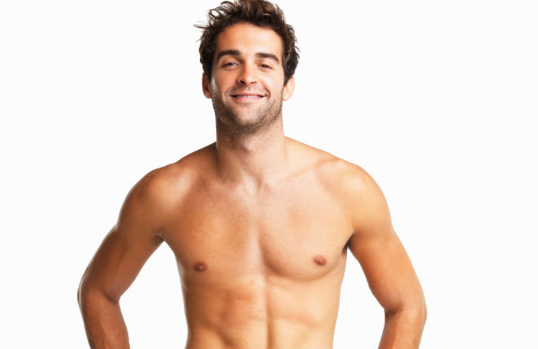 Bare-chested man after laser hair removal treatment