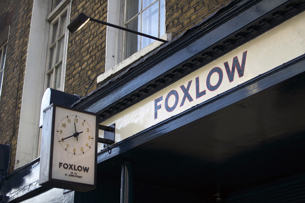 The clock outside Foxlow restaurant in London