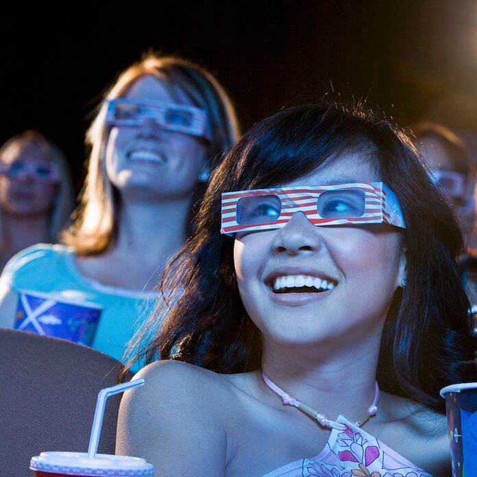 Women watching a movie with 3D glasses