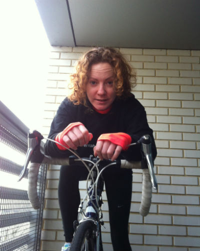 Laura spinning around in her indoor cycling class in London
