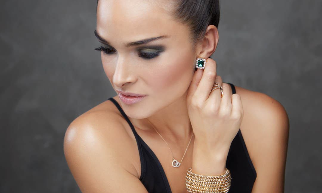 woman wearing glam party jewelry