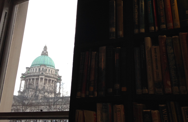 Looking at Belfast City Hall from the window of the Linen Hall Library