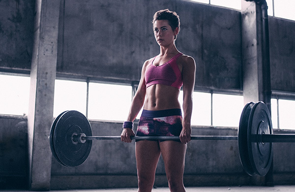 Woman lifting weights in Crossfit gym