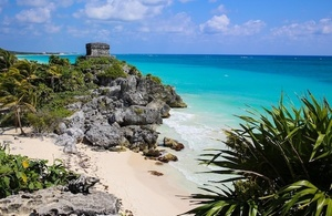 swim next to ancient mayan ruins in tulum mexico