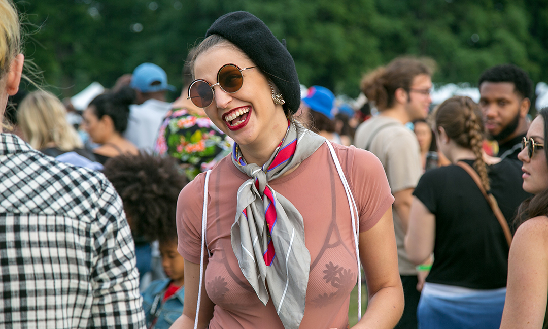 smiling woman in pink at pitchfork