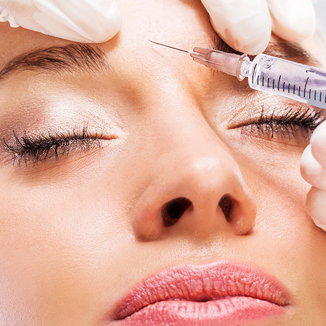 woman getting injected with a Botox alternative between her brows