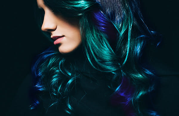 woman with intense green and blue oil slick hair color