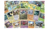 Ihsan Inc: 100 Assorted Pokemon Trading Cards with Bonus 6 Free Holo Foils