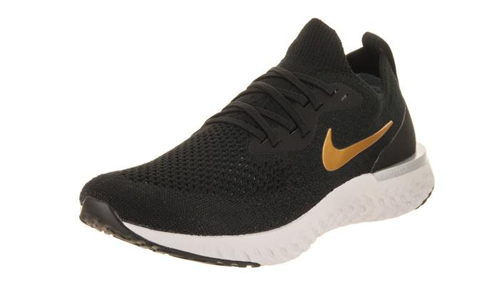99e28c6aebea Nike Women s Epic React Flyknit Running Shoe Medium 8.5 Women US Black Metallic  Gold