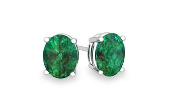 Genuine Oval Cut Emerald Studs Set in Sterling Silver